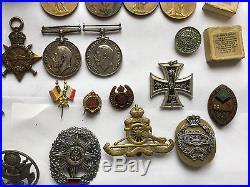 9 x WW1 Medals + 7 x Cap Badges + Princess Mary Tin